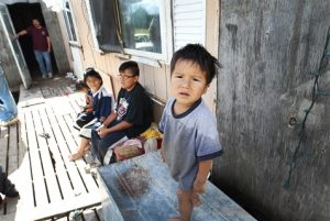 Children outside their trailer in Wasagamack First Nation, Canada