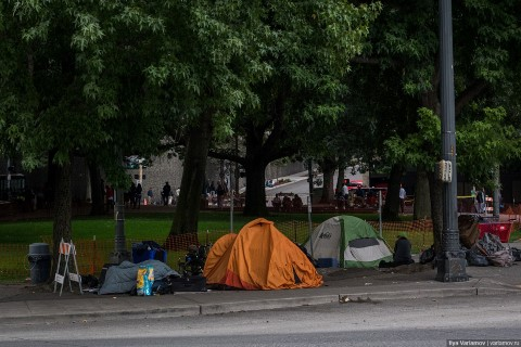 """Camping Out"" in City Park, with the neighbours walking by."